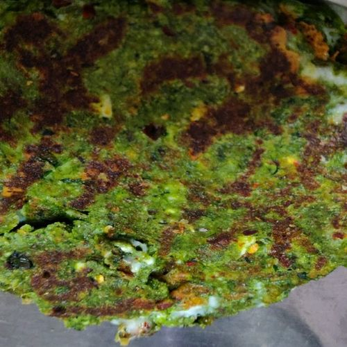 Palak Paneer Paratha stuffed with cheese