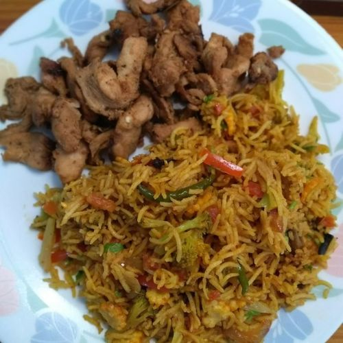 Stewed spicy soy chicken and vegetable pulao