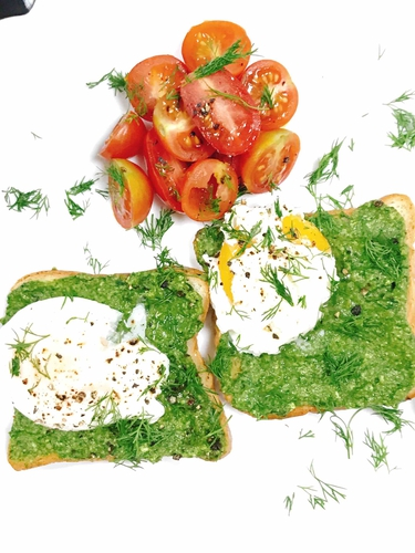 Simple poached egg and spinach avocado toast.