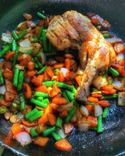 Pan fried chicken with veggies.