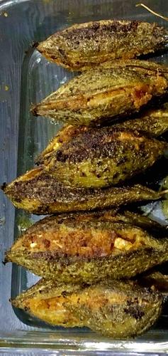 grilled and then stir fried stuffed karela ( bitter gourd)