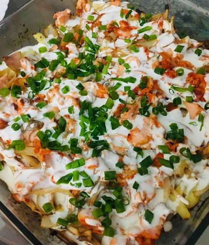 Baked salmon with potatoes and onion