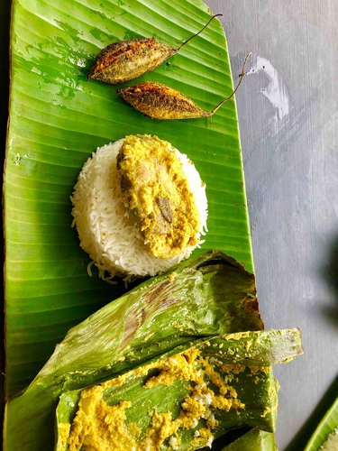 fish paturi ( fish cooked in banana leaves)