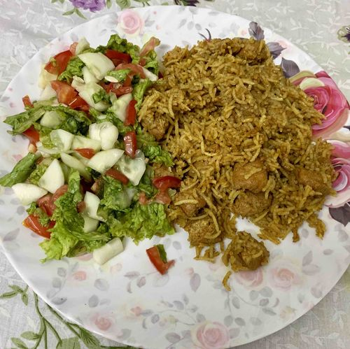 Chicken Sokha rice with salad.