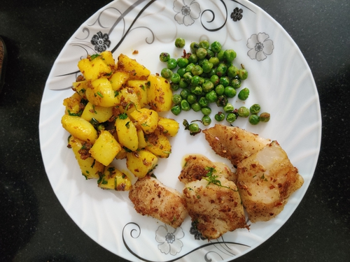 Lemon garlic fish with potatoes and peas