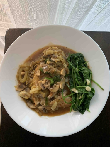 chicken with Leeks and Mushrooms Sauce with sautéed spinach on the side