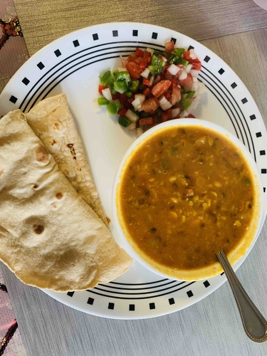 Daal curry with roti and salad