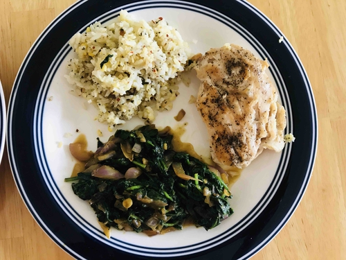 Grilled chicken with spinach and Basil Herb Rice .