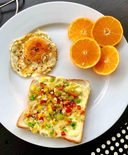 cheese chilli toast , half fry egg , sliced orange