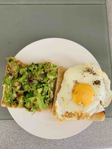 Bread toast with guacamole and egg